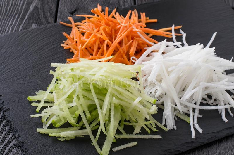 Carrot straw, daikon and green radish royalty free stock photography