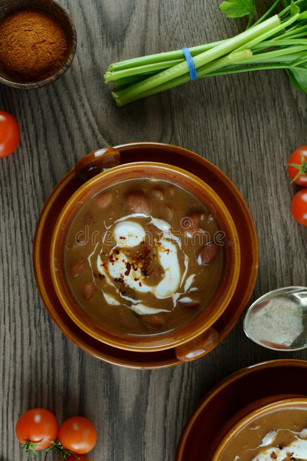 Kidney Bean Stew with Tomatoes and Greek Yogurt Topping royalty free stock images