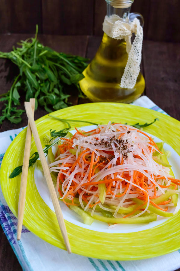 Fresh diet fitness salad of daikon radish, carrots, flax seeds, arugula. stock images