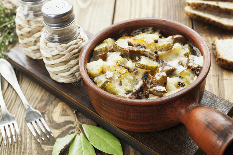 Kidney, stewed with potatoes and pickles. In a ceramic pot royalty free stock photos