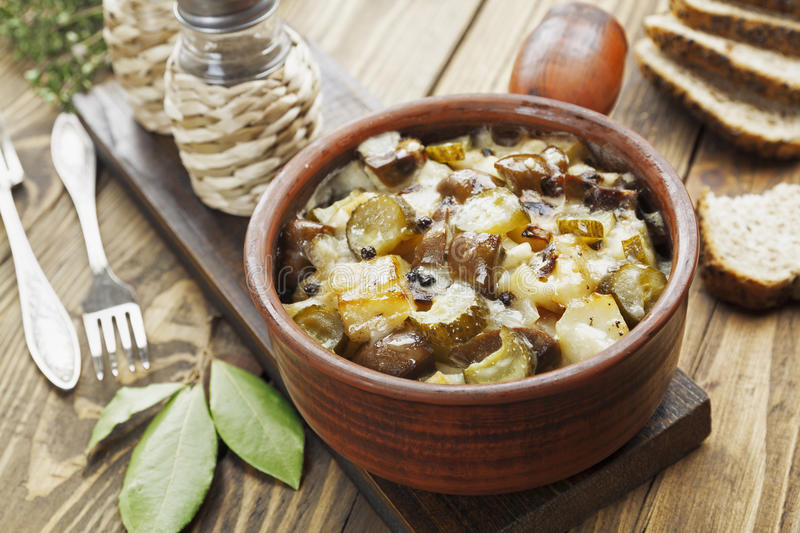 Kidney, stewed with potatoes and pickles. In a ceramic pot stock images