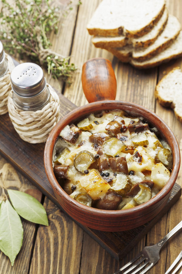 Kidney, stewed with potatoes and pickles. In a ceramic pot stock image