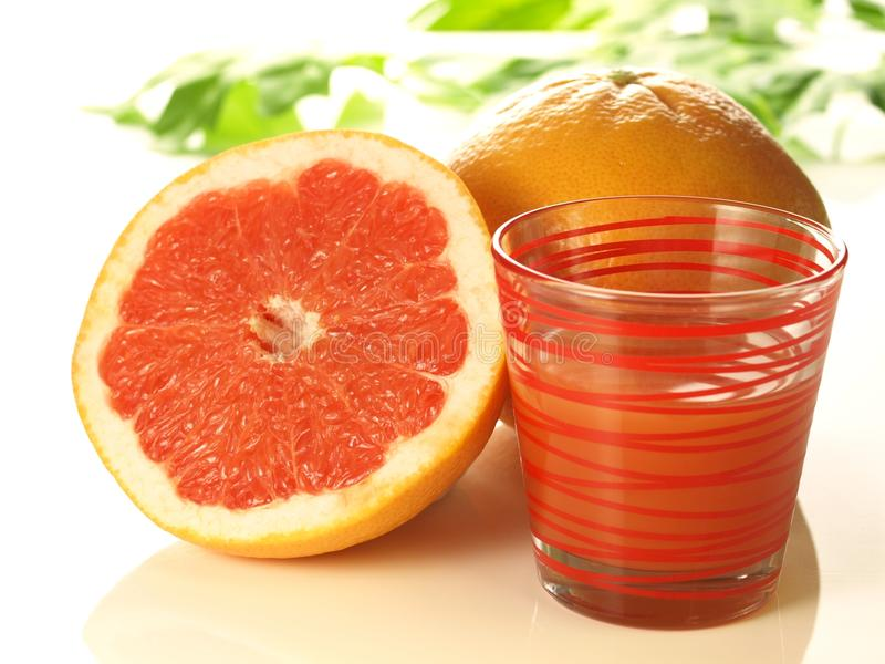 Pink grapefruit with juice royalty free stock photo