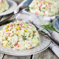 Check out this Russian version of the Imitation Crab Salad. Featuring corn, rice, eggs, and cucumber, it